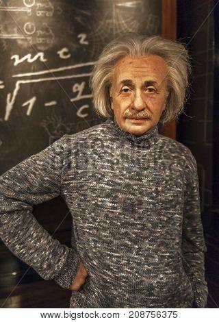 Berlin, Germany - March 2017:  Albert Einstein ax figure in Madame Tussauds museum