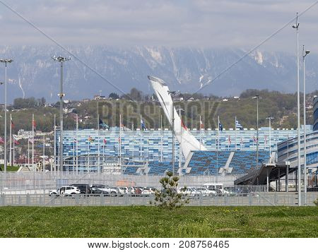 Sochi - March 3 2017: View of the beautiful cup of the Olympic torch in the Olympic Park and the mountains away March 3 2017 Sochi Russia