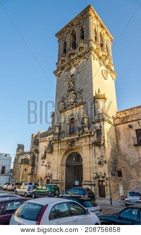 ARCOS DE LA FRONTERA,SPAIN - SEPTEMBER 30,2017 - View at the bell tower of church Santa Maria in Arcos de la Frontera. Arcos de la Frontera is a town and municipality in the Sierra de Cadiz.