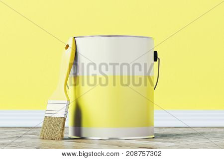 Close up of a yellow paint bucket standing on a wooden floor against a yellow wall with a large paintbrush near it. 3d rendering mock up