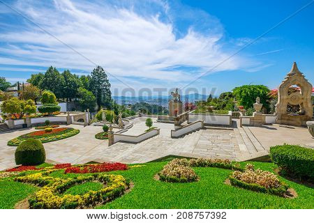 Flower gardens in front of Cathedral of Bom Jesus do Monte. Spectacular aerial view of Braga cityscape, north of Portugal from the top of the popular Sanctuary.