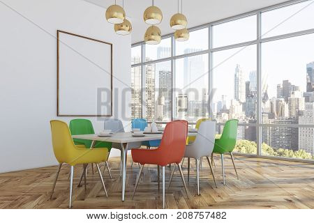 Dining room interior with loft windows white walls and a wooden floor. A long table with colorful chairs and a poster on the wall. Corner. 3d rendering mock up