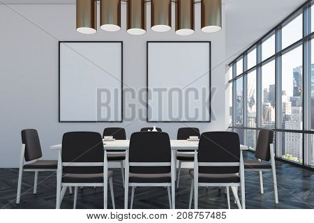 Dining room interior with loft windows white walls and a black wooden floor. A long table with chairs and two posters on the wall. 3d rendering mock up
