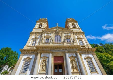 Facade of the Bom Jesus do Monte Sanctuary in neoclassical style in a sunny day. Tenoes near Braga, north of Portugal, Europe. Perspective view from down to up