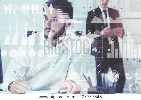 Two young and attractive businessmen working in a white office. Graphs and infographics. Toned image double exposure