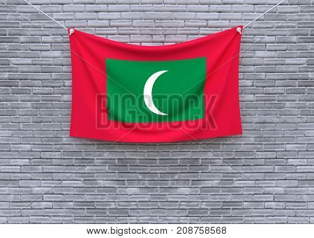 Maldives flag on brick wall. 3D illustration