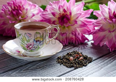 Beautiful Background With Flowers And Cup Of Tea