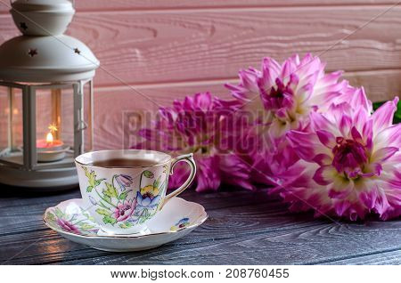 Beautiful Background With A Candle And A Cup Of Tea