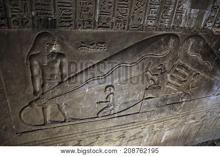 DENDERA TEMPLE, QENA, EGYPT - DECEMBER 05, 2014: Dendera light, controversially used as proof that the ancient egyptians had access to electricity in the crypt of goddess Hathor at Dendera