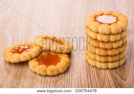 Heap And Stack Of Cookies With Jam On Table