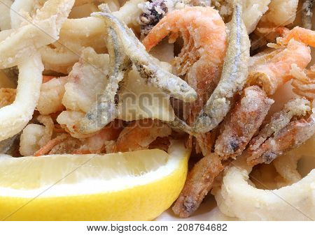 Appetizing Background Of Many Fried Fish With Shrimp In A Pan An