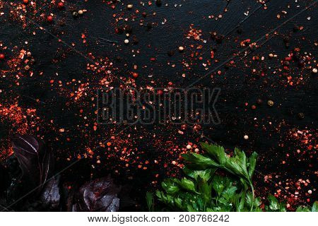 organic spice mix basil parsley dark background
