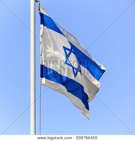 One flag of Israel on sky background