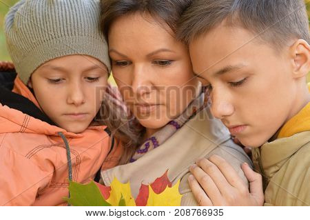 mother, daughter and son, upset posing outdoors