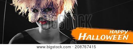 Digital image of happy Halloween text against portrait of woman in masquerade mask and wig