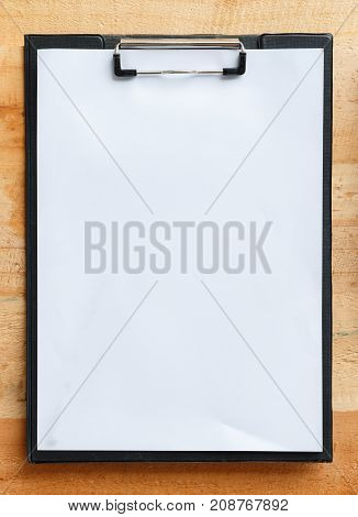 Close up top view paper board with white space use for your texts display