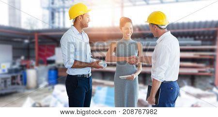 Architect doing handshake against building site