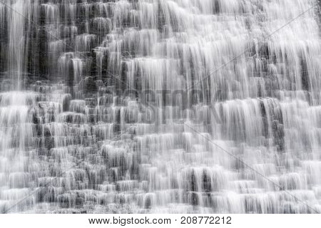 Closeup Of Cascading Waterfall In Small Tiers With Smooth Flowing Motion