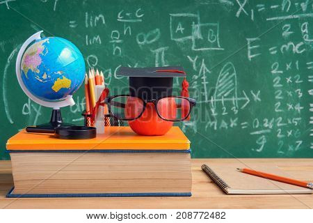 Apple Knowledge Symbol And Pencil Books On The Desk With Board Background