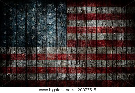 American flag painted on fence background.