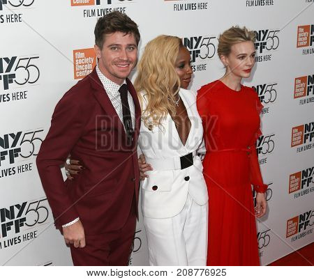 (L-R) Garrett Hedlund, Mary J. Blige and Carey Mulligan attend the