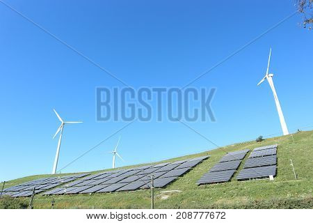 Restored sanitary landfill cell with photovoltaic cells and wind turbine