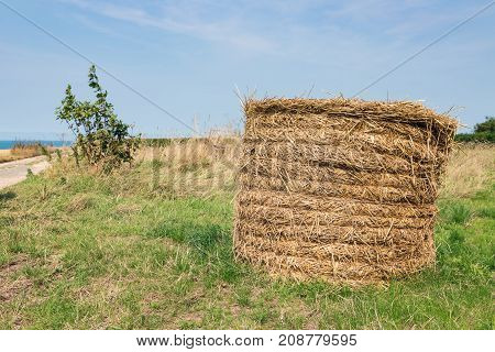 Rural landscape with big haystack near coast of Normandy, France