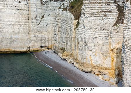 Colorful vertical limestone cliffs with beach near Etretat in Normandy, France
