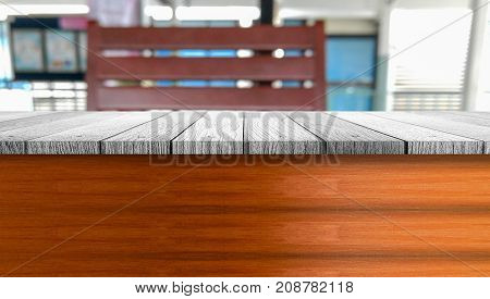 Close up wooden table top with chair