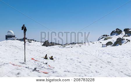 Skiing winter season mountains and ski equipments on ski run
