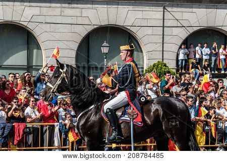 Madrid Spain - October 12 2017: Guardia Civil calvary marching in Spanish National Day Army Parade. Several troops take part in the army parade for Spain's National Day.