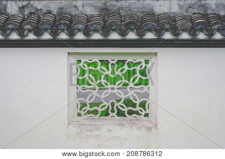 White square window Chinese style old fashioned decoration with green natural background at Chinese garden.