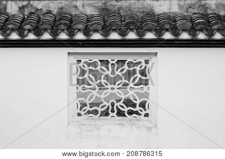 White square window Chinese style old fashioned decoration with green natural background at Chinese garden. (Black and White filter effect)