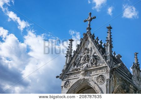 Mausoleum place of burial with blue sky and clouds