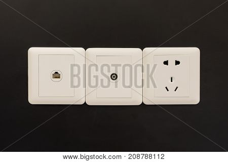 White Electric Plugs Or Outlet On Wall, With Tv And Tel