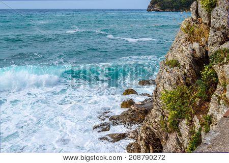 View of the sea. The waves break down on the coastal rocks. Summer. Balkans. Adriatic