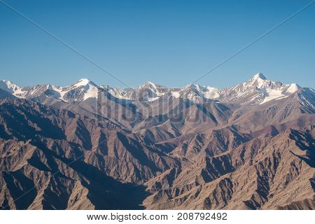 Closeup image of the Himalaya mountain in winter with clear blue sky