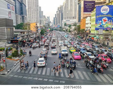 BANGKOK THAILAND - MARCH 2 2017: Heavy traffic jam in Asoke junction. Vehicles lined up on street from one to another junction for 1.5 kilometers.