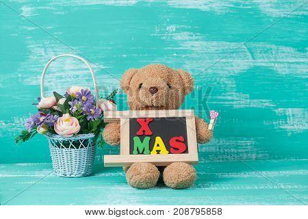Bear Toy With X Mas Text On Blackboard