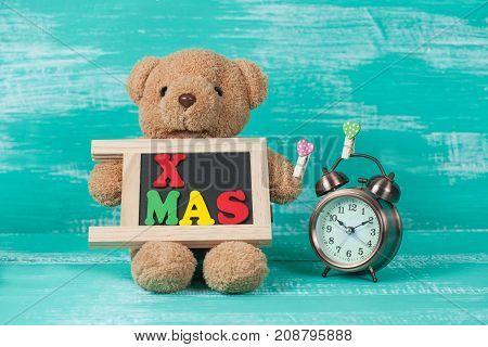 X Mas Text On Blackboard  And Clock