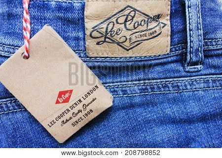 MOSCOW, RUSSIA - OCTOBER 8, 2017: Lee Cooper Denim Blue Jeans with Brand New Labels. Lee Cooper is English clothing company, operating worldwide. Famous lifestyle urban fashion clothes in Europe