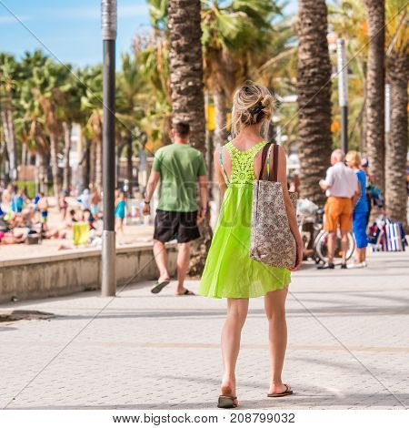 People Walk Along The Embankment, Salou, Tarragona, Spain. Close-up.