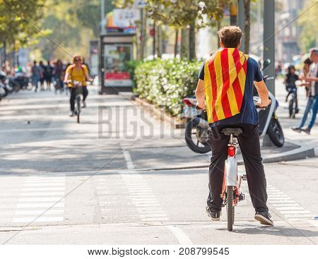 Cyclist At A Demonstration In The City Center, Barcelona, Catalunya, Spain. Copy Space For Text.