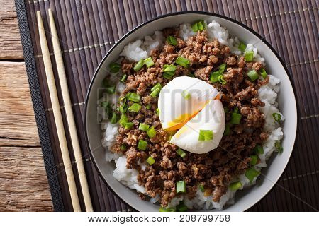 Japanese Dish: Spicy Meat Soboro With Egg Poached And Rice Close-up In A Bowl. Horizontal Top View