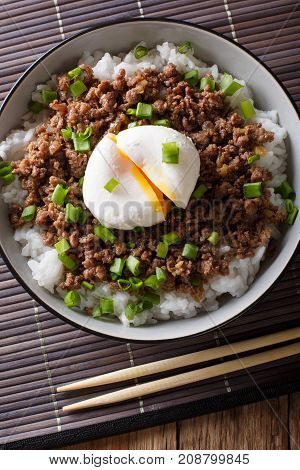 Beef Soboro With Egg Poached, Rice And Green Onion Close-up. Vertical Top View