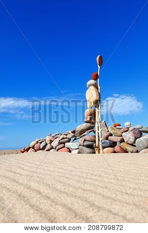 Balance stones on the beach in summer. The concept of the imagination