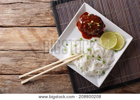 Delicious Hambagu Steak With Gravy And Rice Vermicelli Close-up On A Table. Horizontal Top View