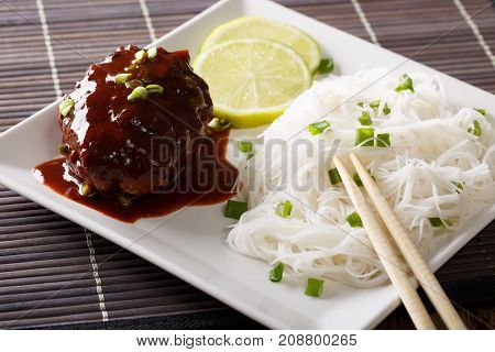 Delicious Hambagu Steak With Gravy And Rice Vermicelli Close-up On A Table. Horizontal