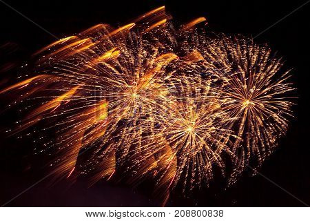 Many beautiful Golden fireworks exploding in the night sky