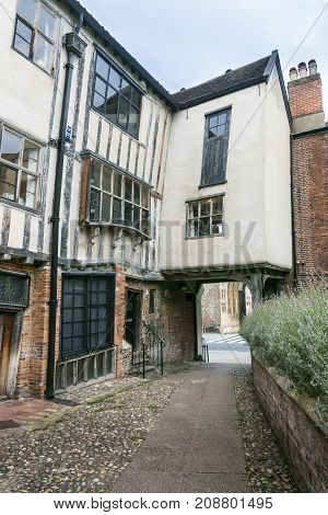 Ancient English buildings in Tombland Alley Norwich Norfolk UK